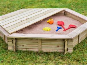 Hexagonal sandbox with a cover